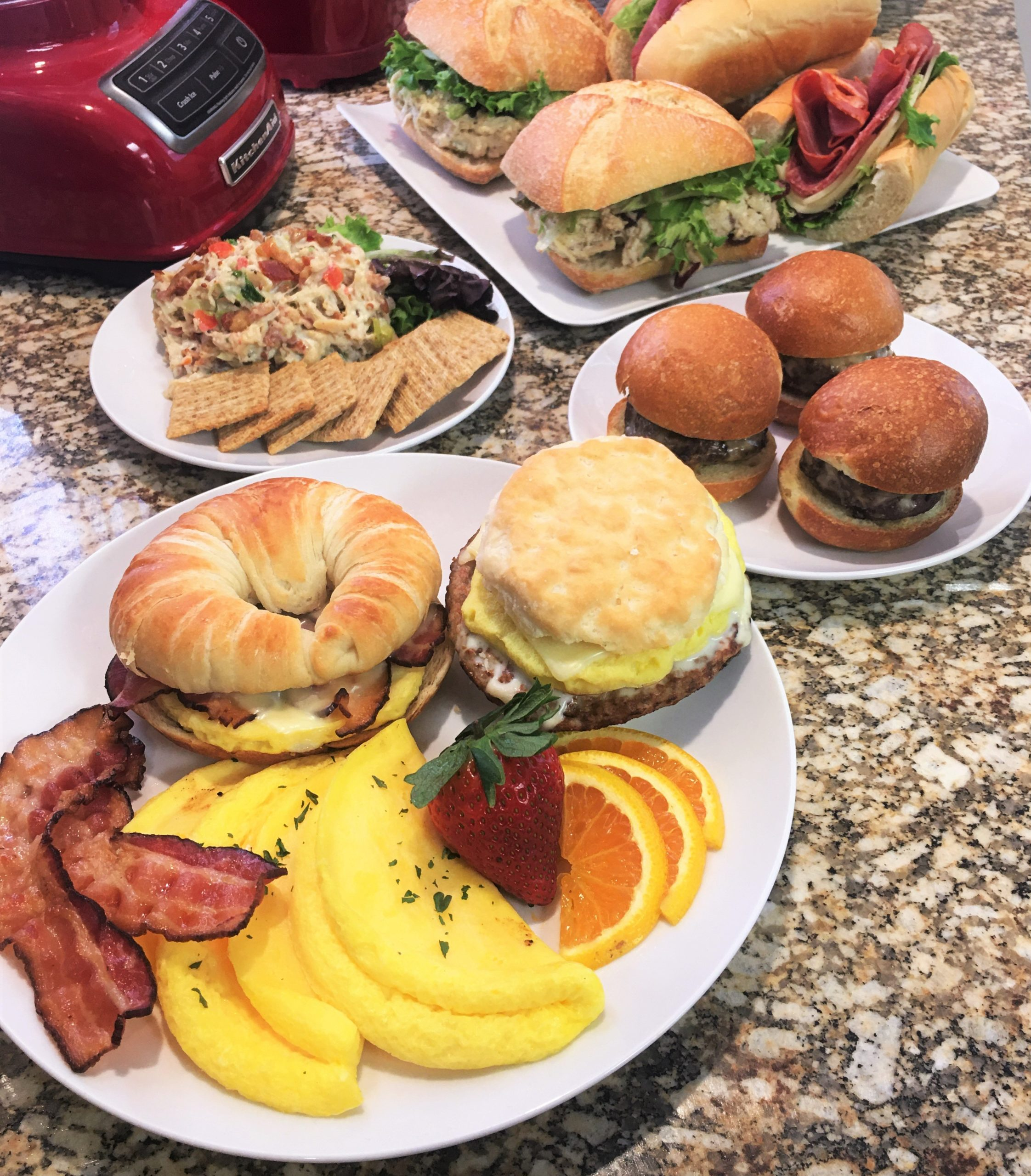 assortment of freshly prepared foods for breakfast, lunch, and dinner takeout